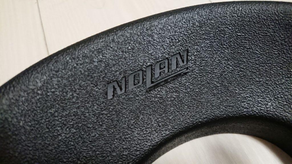 NOLAN「ヘルメットメンテナンス リング」のロゴ。